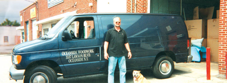 Marty Maher with his dog Betsy at Oceanside Woodwork